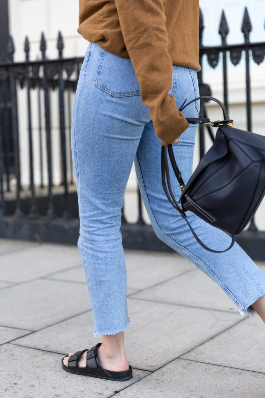 A close-up of Anna's jeans and sandals.