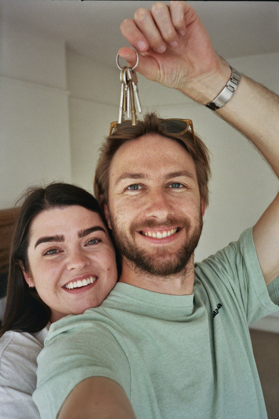A photo of Anna and Mark with the keys, before they passed them on to the new owners.